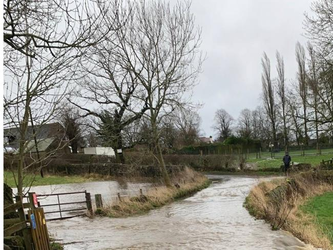 Wills Gill pictured during flooding this month. The photograph is from the website of Aireborough Neighbourhood Development Forum.