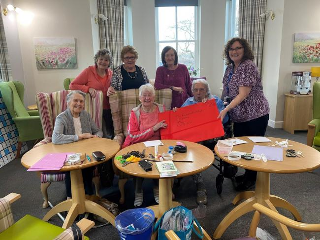 Residents at Grove House with the giant cards