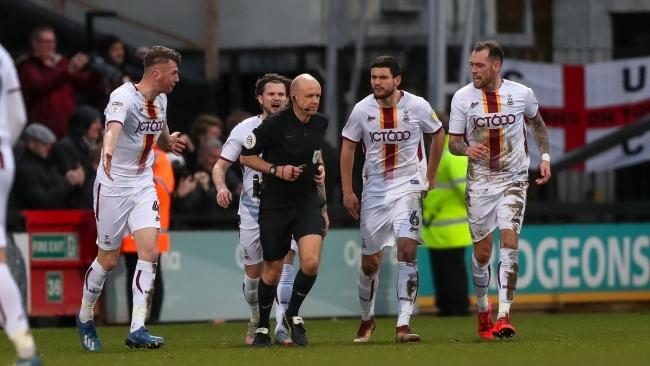City players surround referee Nick Kinseley at the final whistle. Pic: Thomas Gadd
