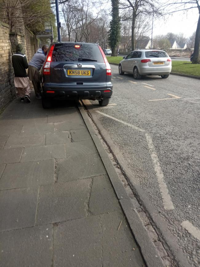 What gives this person the right to park like this? When it is a public footpath, as you can see he's not only parked illegally, he's also blocked people from passing and also people from getting to the bus stop. This photograph was taken on 7 February at 1:35pm.
