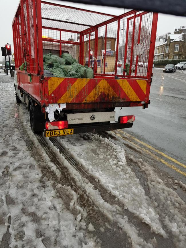 Thornton Road Girlington. Monday morning. 9am. Heavy snow. Van parked on double yellows in front of traffic lights and crossing. While occupants in cafe having a breakfast. Disgraceful. Dangerous.