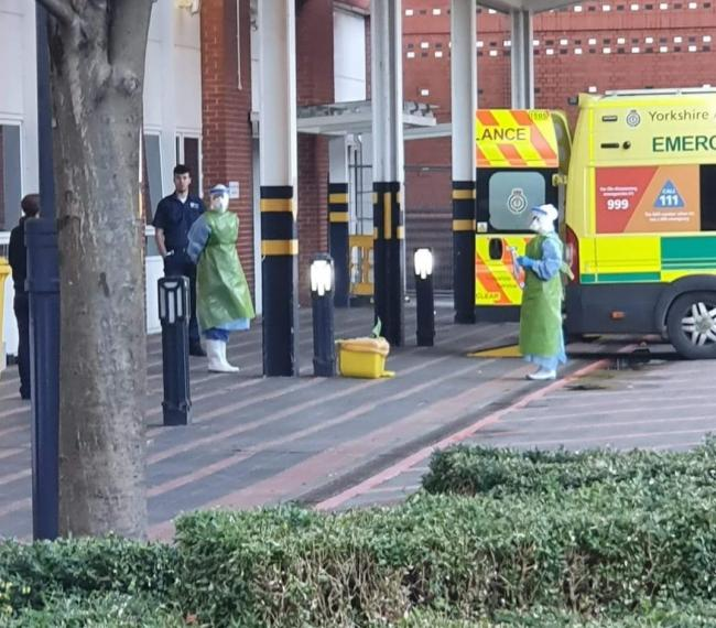 CORONAVIRUS: Medical workers in protective clothing outside local hospital spark fears