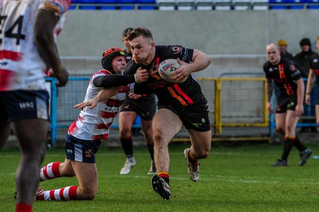 Sam Hallas on the charge against Oldham shortly before the lockdown. Picture: Tom Pearson