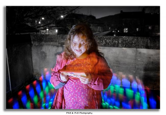 Zarah Bailey as Hermione Granger and also reading snow white out side while being light painted