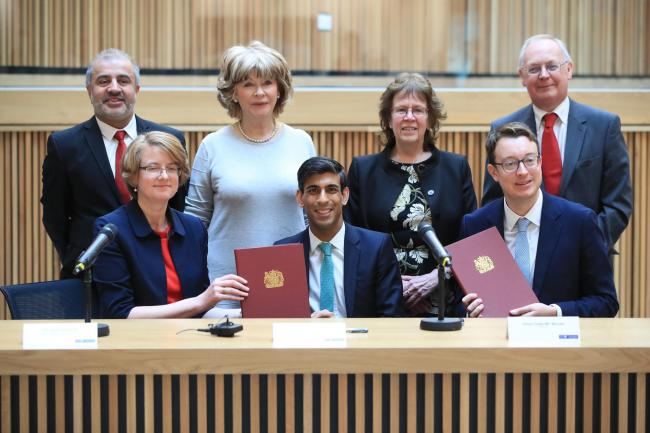 (back row, left to right) Councillors Shabir Pandor, Denise Jeffery, Judith Blake and Tim Swift, (front row, left to right) Susan Hinchcliffe, Chancellor Rishi Sunak and Simon Clarke MP after the signing of the West Yorkshire Combined Authority devolution