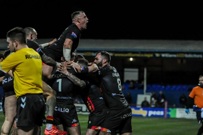 Bulls celebrate scoring during their Challenge Cup loss at Wakefield Trinity. Picture: Tom Pearson