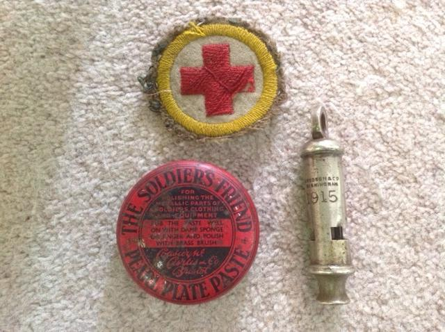 Stretcher bearer's arm badge, Pearl Plate Paste for cleaning buttons and officer's whistle found in a field in France are among 'Show and Tell' items