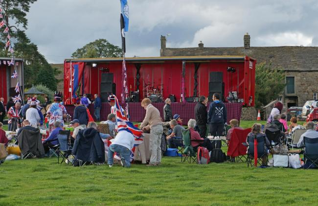 Revellers enjoy a picnic before a previous Proms on the Farm event