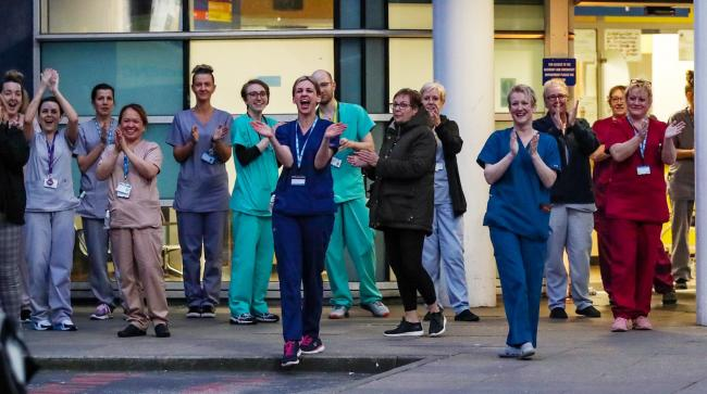 NHS staff join in the national applause during the Clap for Carers. Photo: Peter Byrne/PA Wire