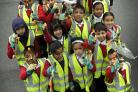 Neighbourhood wardens and pupils from Barkerend Primary School are working together to help tidy up the streets around where they live