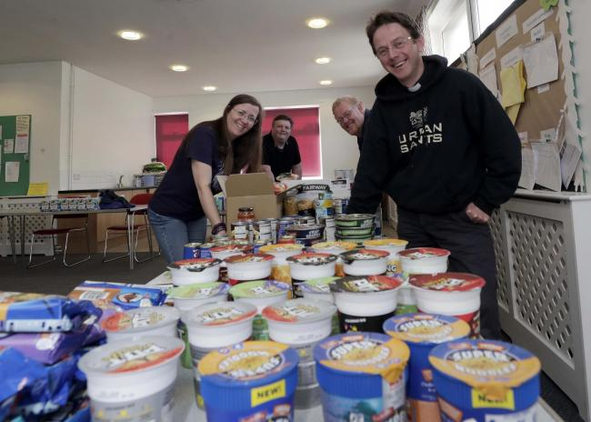 Packing food parcels at the Cleckheaton foodbank for delivery at Cleckheaton Methodist Church. Josie Pugsley, Clr John Lawson (centre) Rev Ray Borrett and Rev Brunel Jones.