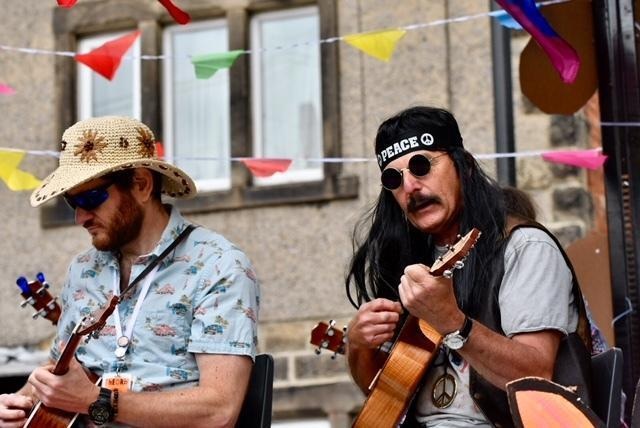 Members of Otley Ukulele Orchestra playing from a float at the 2018 Otley Carnival