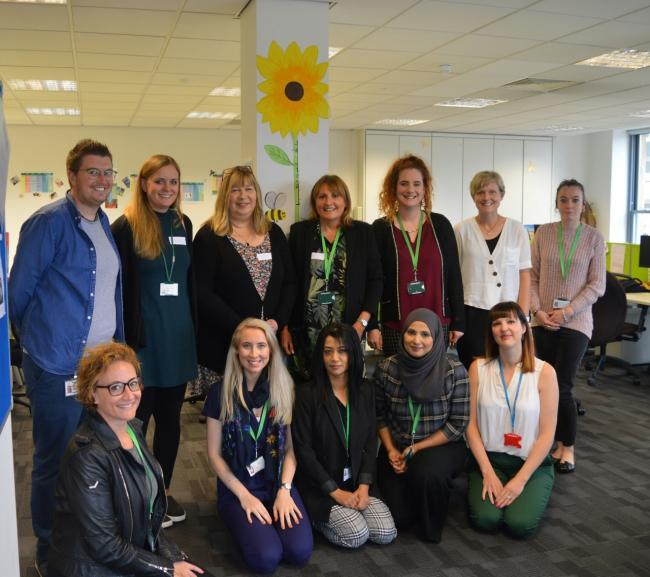 A photo of NSPCC staff - which was taken before lockdown - as the charity seeks to adapt to the challenges of the current climate