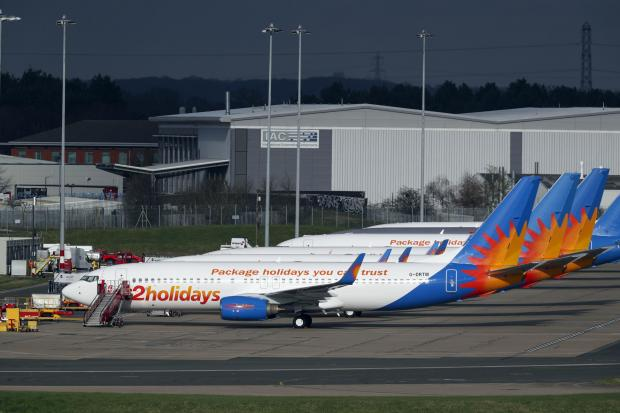 Bradford Telegraph and Argus: AIRLINE: Several Jet2 planes have been parked up at Birmingham Airport during the pandemic. Picture: Steve Parsons/PA