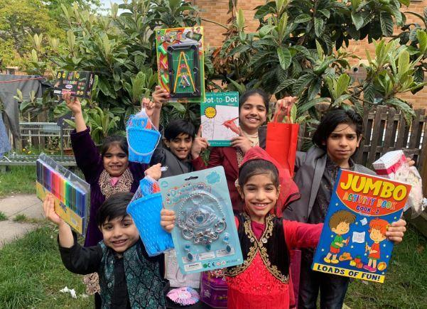 The Hussain family give gifts to make their neighbours smile