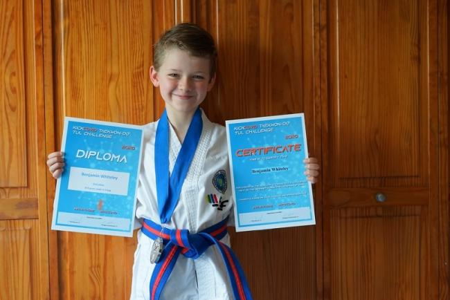 Benjamin Whiteley stands proudly with his certificates after his amazing video effort Picture: Mark Whiteley