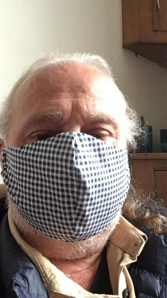 Ilkley Town Councillor Peter Mate weariing one of the face coverings