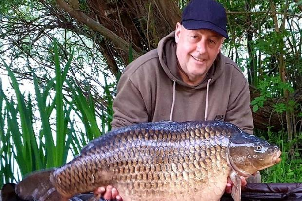 Allan Allcock with his 41lb 6oz carp from Knotford, a new lake record