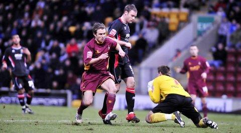 Chris Brandon tries to add to City's only goal in their draw with Cheltenham but keeper Scott Brown denies him