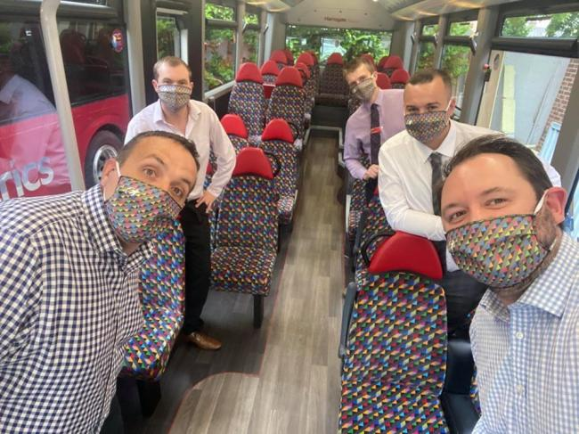 Transdev Operations Director Vitto Pizzuti (front left) and CEO Alex Hornby (front right) with Transdev's team sporting the bus firm's specially designed face coverings in the colours of each of its companies
