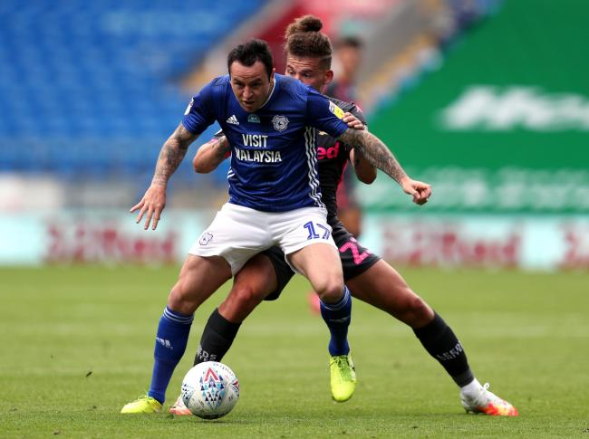 Cardiff City's Lee Tomlin and Leeds United's Kalvin Phillips during the Sky Bet Championship match at Cardiff City Stadium