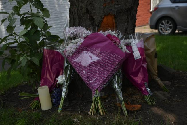 Floral tributes left at the scene on Harrogate Road, Apperley Bridge