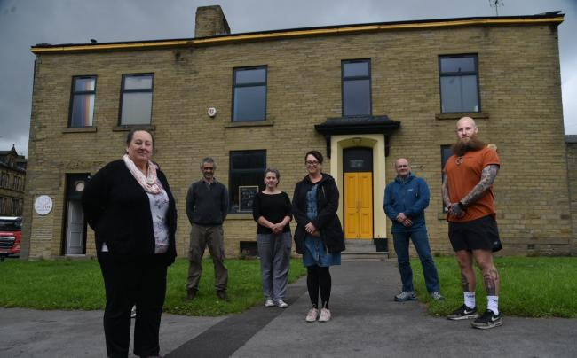 Inn Churches team members stand outside the charity's new premises in Bradford