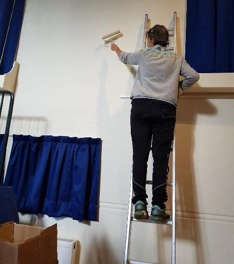 A volunteer working to prepare Otley Courthouse for its reopening