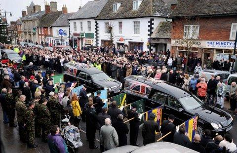 The coffins of Sapper David Watson and Rifleman Aidan Howell passing through Wootton Bassett after they were repatriated to RAF Lyneham, Wiltshire, last Tuesday.