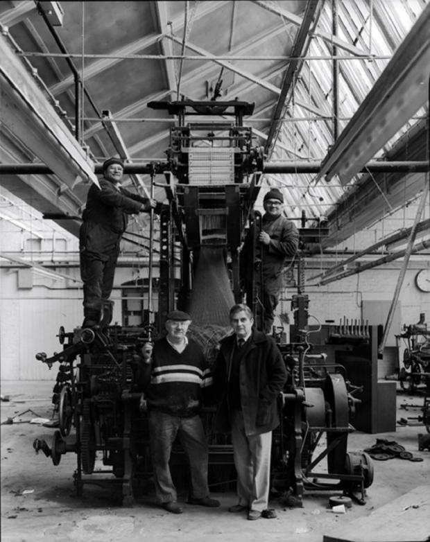Bradford Telegraph and Argus: The last loom is removed from Salts Mill 9th May 1986. Bottom right is Harry Burnett, the last weaving shed manager. This was the end of 133 years of production