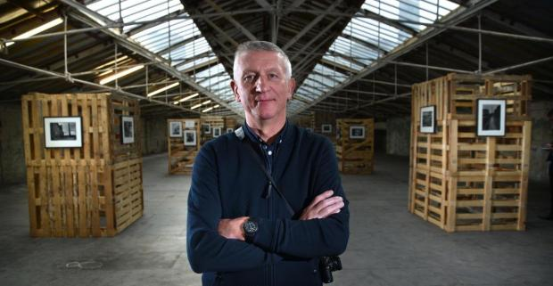 Bradford Telegraph and Argus: Photographer Ian Beesley in 2017 in the exhibition of images he made during the changes at Salts Mill during the final years of production in the 1980s
