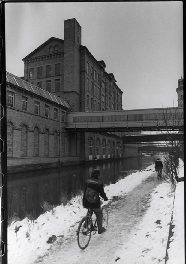 Bradford Telegraph and Argus: Workers cycling to work on the Leeds and Liverpool Canal towpath, Saltaire in 1986