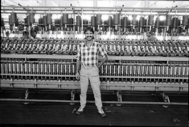 Bradford Telegraph and Argus: A happy spinner at Salts Mill in 1986