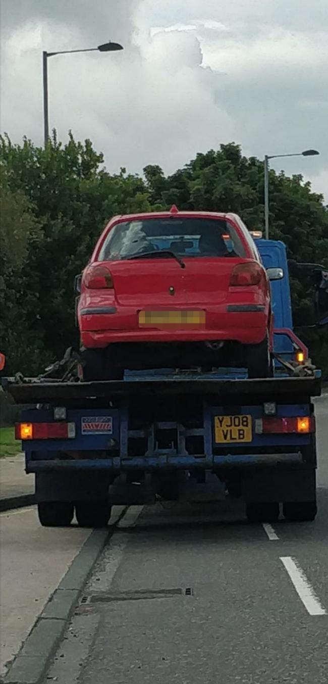 Police seized this red car after the driver was caught going around Odsal Top roundabout the wrong way.
