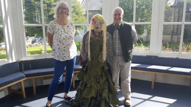 Burley Summer Festival Chair Jan Lepley with committee member Keith Galvin and Brunhilda the scarecrow