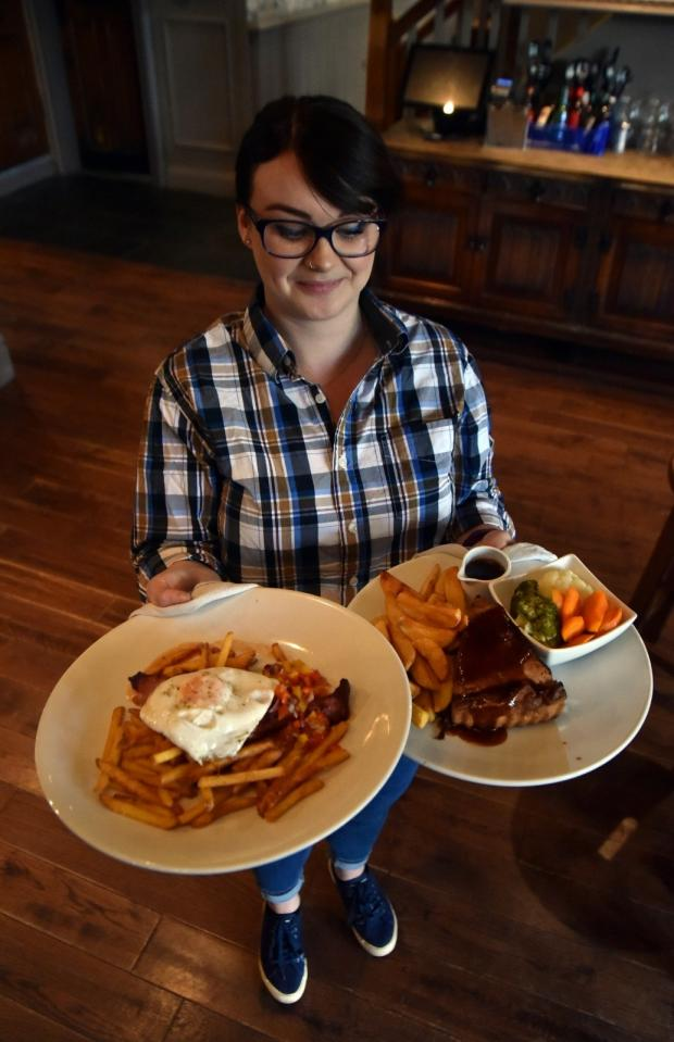 Bradford Telegraph and Argus: Tanya Gillow serves up meals at The Brown Cow, Bingley