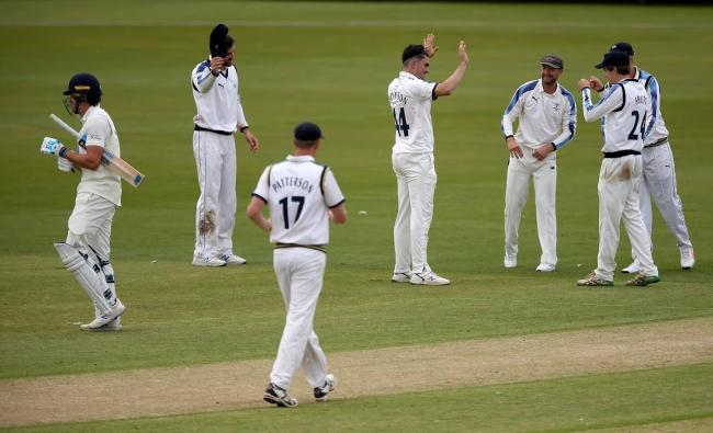 Jordan Thompson (fourth left) celebrates taking the wicket of Durham's Paul Coughlin during Yorkshire's win at Emirates Riverside this week Picture: Chris Booth