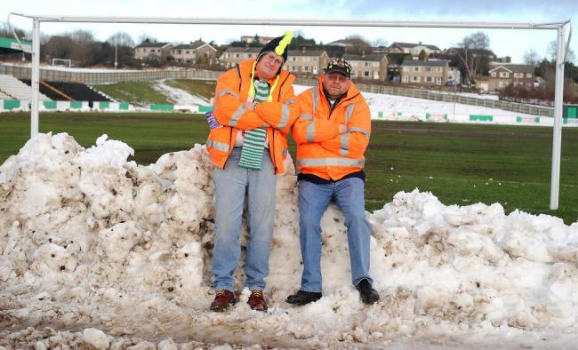 Avenue stewards Pete Hearn and Ian Sewell look forlorn as the match against Guiseley was postponed but Horsfall Stadium is back to somewhere near its best now