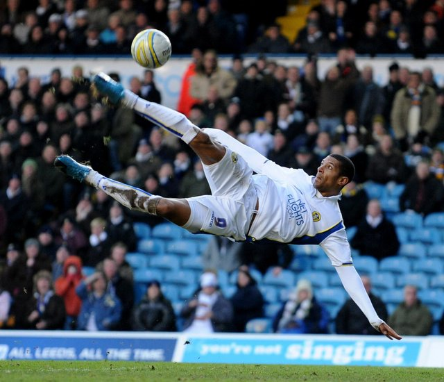 Jermaine Beckford in acrobatic action against Colchester