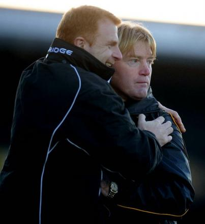 City's jubilant assistant manager Wayne Jacobs hugs Stuart McCall after Gareth Evans' injury-time winner