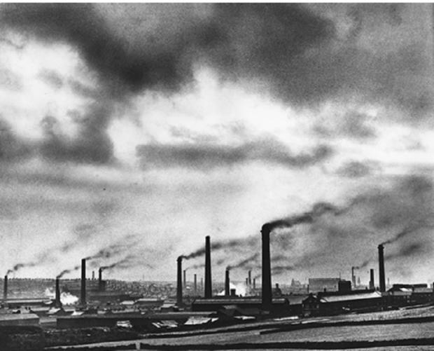 Bradford Telegraph and Argus: CH Wood's 1947 smoke in Bradford photograph, the inspiration for 'Bruised Air'