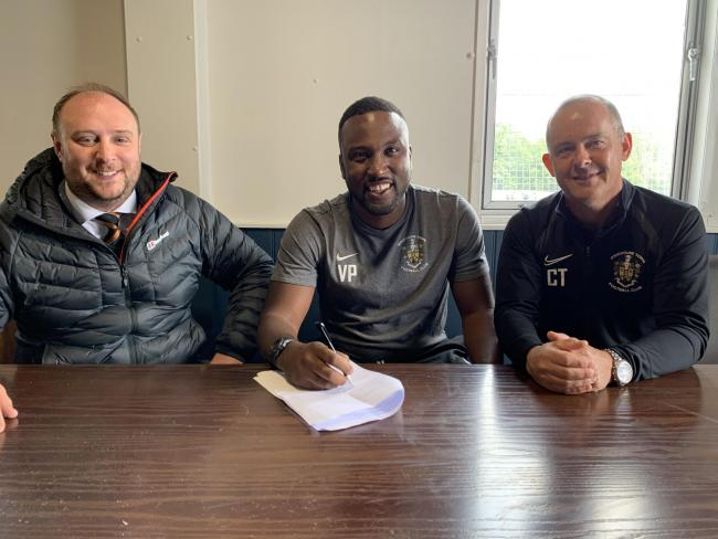 Boss Vill Powell (centre) is happy to have snapped up Brett Souter after the departure of young Manchester United loanee Jacob Carney.