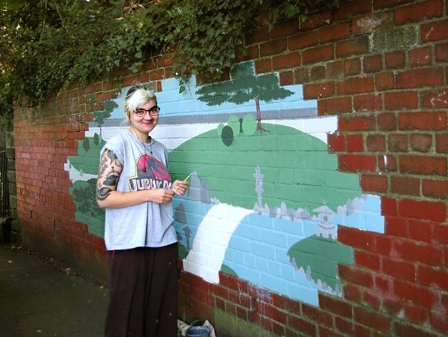 Artist Molly Walsh creating her mural in Otley. John Morgan