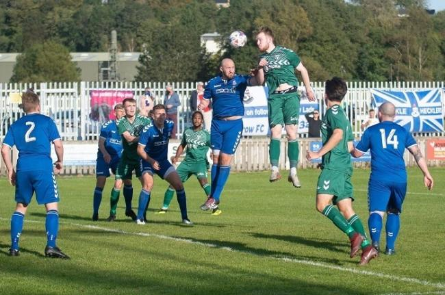 Andy Briggs (heading the ball) netted for Steeton in their 4-4 draw with Campion last night Picture: John Chapman