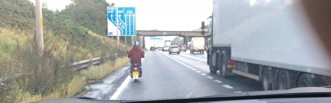 Police stopped a 50cc scooter which was riding illegally on the M62.
