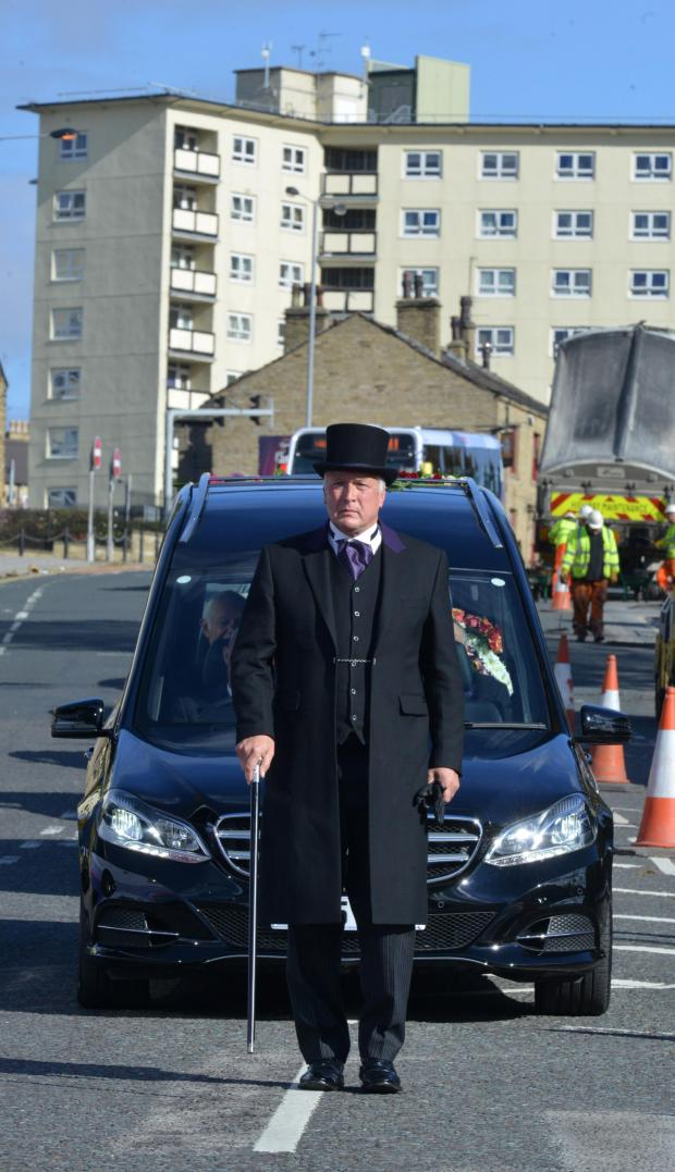Bradford Telegraph and Argus: The funeral cortege of Geoffrey Brindley - 'Bradford Jesus Man'