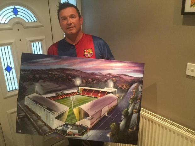 Bradford Telegraph and Argus: Paul Town with one of his stadium paintings