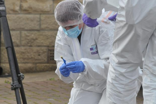 Bradford Telegraph and Argus: Forensics officers recover a bullet shell in Coleshill Way, Bierley