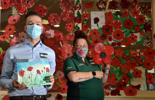Blane Turner , manager at Morrisons in Girlington, with Lily Romani, the store's community champion