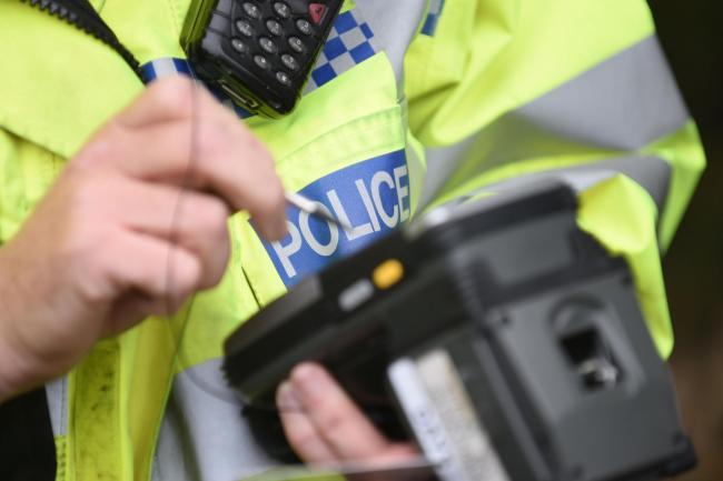 Police are trying to locate a good Samaritan who helped a robbery victim in Huddersfield